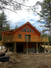 Log home with deck/porch